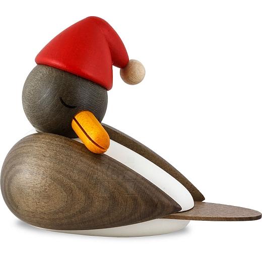 Weihnachtsmöwe schlafend mit grauen Flügeln