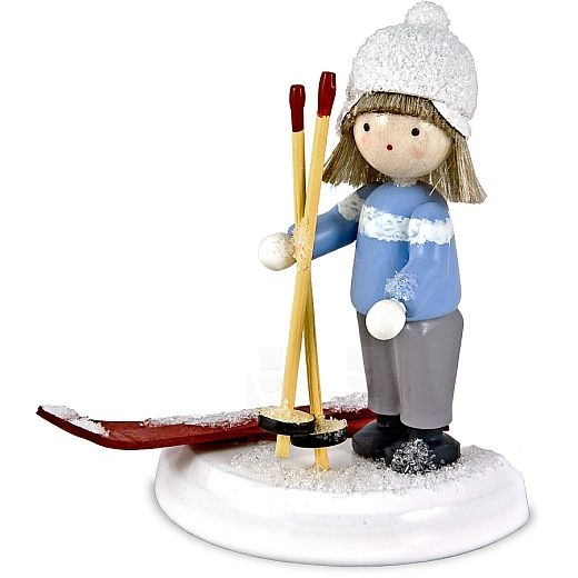 Junge mit Skiern