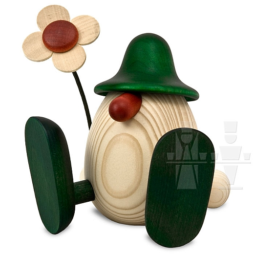 Eierkopf Erwin mit Blume sitzend grün