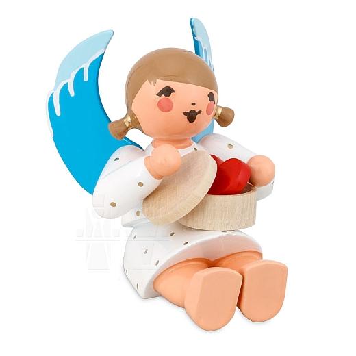 Engel sitzend mit Spandose und Herz weiß