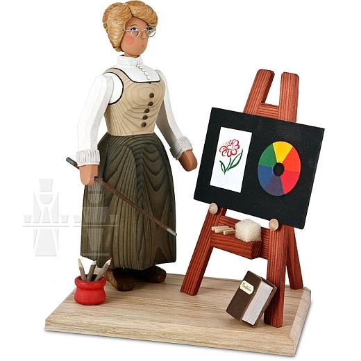 Dorfschullehrerin mit Tafel