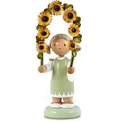 Mädchen mit Blumengirlande