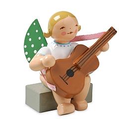 Engel mit Gitarre, sitzend