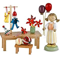 Marktsstand Spielzeughändlerin