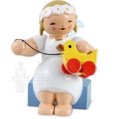 Margeritenengel sitzend mit Spielzeugente