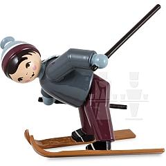 Skianfänger Junge Schneepflug fahrend lila