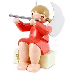 Engel sitzend auf Geschenkpaket mit Querflöte rot