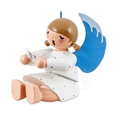 Engel sitzend mit Notenblatt weiß
