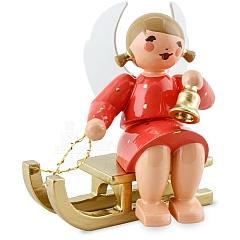 Engel sitzend auf Schlitten mit Glocke rot