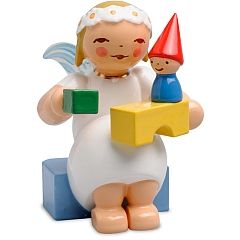 Marguerite angel sitting with Building Blocks