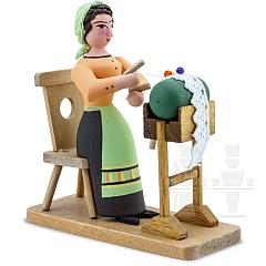 Frau mit Klöppelsack