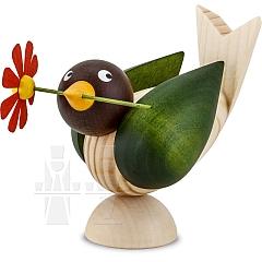 Vogel mit Blume im Schnabel natur Flügel grün