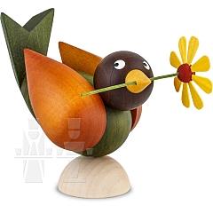 Vogel mit Blume im Schnabel grün Flügel braun