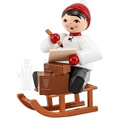 Weihnachtspost Junge auf Schlitten rot von Ulmik