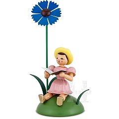 Blumenkind farbig sitzend mit Kornblume und Notenbuch