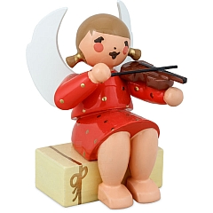 Engel sitzend auf Geschenkpaket mit Geige rot