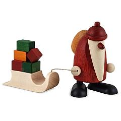 Weihnachtsmann mit Geschenkeschlitten